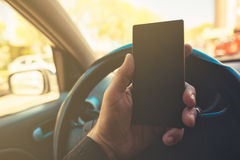 Using mobile phone and driving car Stock Photo