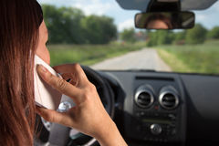 Using a mobile phone while driving Royalty Free Stock Image