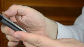 Using mobile phone. Man`s hand using a mobile phone with touchscreen stock footage