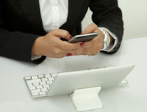 Using Mobile Phone in the Office Royalty Free Stock Images