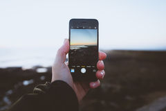 Using mobile phone to take a picture Stock Photo