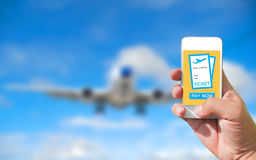 Using mobile smart phone buy ticket Airport Flight. Airplane bac. Kground bulr Stock Photography