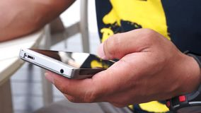 Using mobile smart phone. Close up of a man using mobile smart phone stock footage