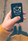 Using mobile smartphone to access e-mail inbox Royalty Free Stock Photo