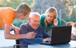 Using the modern technology. Old grandfather learning how to use modern technology Stock Photos