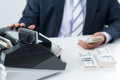 Using money counting machine Royalty Free Stock Images