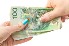 Using money - finances - loan - Poland. Giving money - finances, loan, handing in Royalty Free Stock Photography