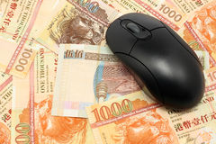 Using money online. By mouse Royalty Free Stock Photo