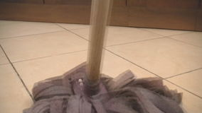 Using mop to clean a tile floor. Full HD stock video footage