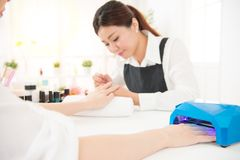 Using nail polish curing dryer light Stock Image