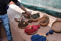 Using natural dyes for wool in Cuzco, Peru. Traditional weavers use food and plants from nature to dye wool in Cuzco, Peru royalty free stock photography