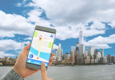 Navigation system or GPS smartphone. Using the navigation system or GPS smartphone mobile phone to navigate to your destination Royalty Free Stock Photography