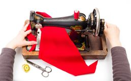 Using an old sewing machine Royalty Free Stock Image