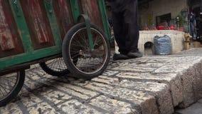 Using old tire as a brake on steep street of Jerusalem. Israel stock footage