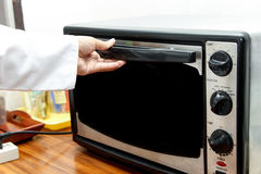 Using oven Stock Photography