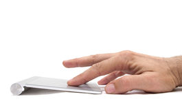 Using a pad. Image of a hand using a touchpad Royalty Free Stock Photography