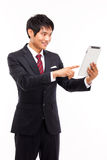 Using pad PC business man. Royalty Free Stock Image