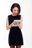 Using pad PC business woman Stock Photo
