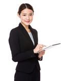Using pad PC business woman Stock Image