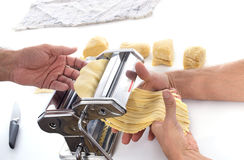 Using a pasta maker Royalty Free Stock Image