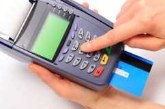 Using payment terminal, enter personal identification number Stock Photography