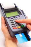 Using payment terminal, enter personal identification number Stock Photo