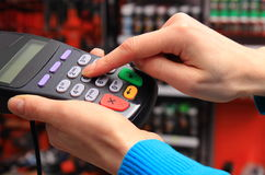 Using payment terminal, enter personal identification number Royalty Free Stock Image