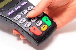 Using payment terminal, enter personal identification number Royalty Free Stock Photo