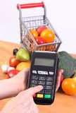 Using payment terminal, fruits and vegetables, cashless paying for shopping, enter personal identification number Royalty Free Stock Photos
