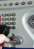 Using payphone with credit card. Use public phone with a credit card Stock Photo