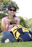 Using PDA. Young Lady in Casual Attire Using PDA Royalty Free Stock Images