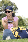 Using PDA. Young Lady in Casual Attire Using PDA Stock Images