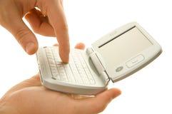 Using pda. Palmtop in hand Stock Image