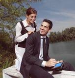Using PDA outdoors yu Stock Photos