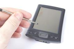 Using a PDA pen Royalty Free Stock Photos