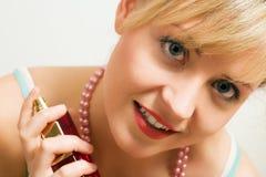 Using Perfume Royalty Free Stock Photos
