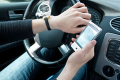 Using phone while driving Royalty Free Stock Photos