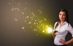 Using phone with gold sparkling concept stock photos