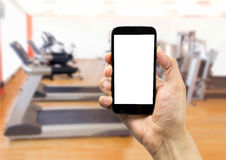 Using the phone at gym Royalty Free Stock Photos