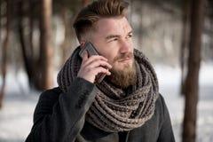 Using phone in winter Stock Photos