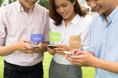 Using phones. Young people using social network on the phone Stock Images