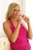 Using Pink Toy Camera Stock Image
