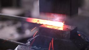 Using pneumatic hammer to shape hot metal. stock video footage