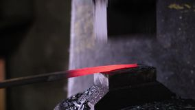 Using pneumatic hammer to shape hot metal. stock footage