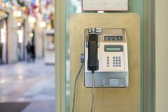 Using of public payphone. old payphone in the street f. Using of public payphone. old payphone in the street stock photo