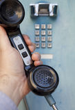 Using a public telephone Stock Photos