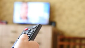Using a Remote Control To Browse Channels. 4K Video Of Using a Remote Control To Browse Channels stock video footage