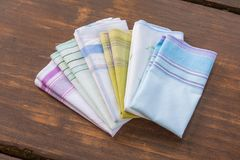 Reusable 100 percent cotton handkerchiefs. Using reusable textile, pure cotton colourful handkerchiefs for blowing nose instead of single use paper tissues stock photography