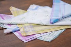 Reusable 100 percent cotton handkerchiefs. Using reusable textile, pure cotton colourful handkerchiefs for blowing nose instead of single use paper tissues Stock Image