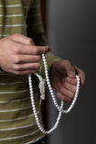 Using Rosary Beads In Hands Royalty Free Stock Photography